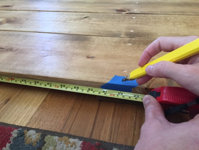 Mark the center of your headboard with painters tape