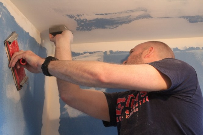 Jesse sanding drywall joint compound