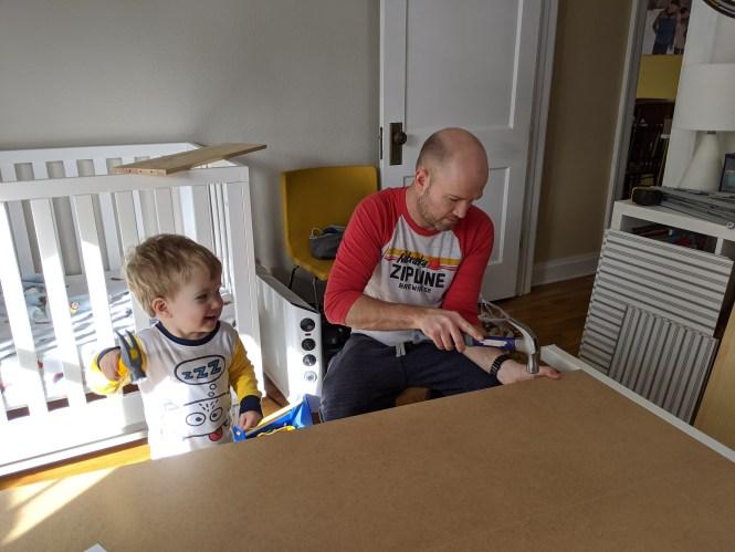 Henry helping Jesse assemble dresser