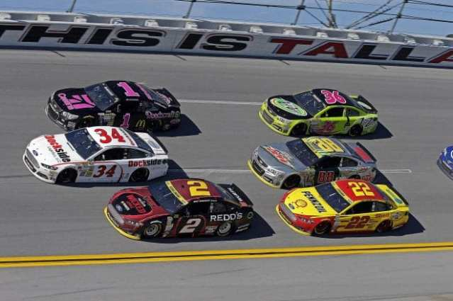 Sprint Cup cars racing in the pack at Talladega Superspeedway