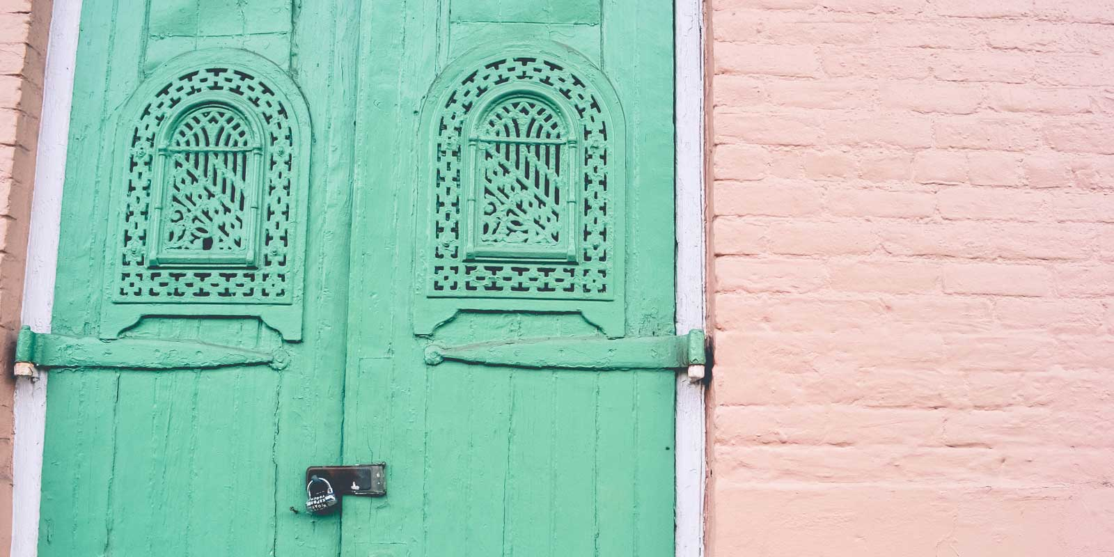 Colorful homes are everywhere in New Orleans, like this pink and mint abode.