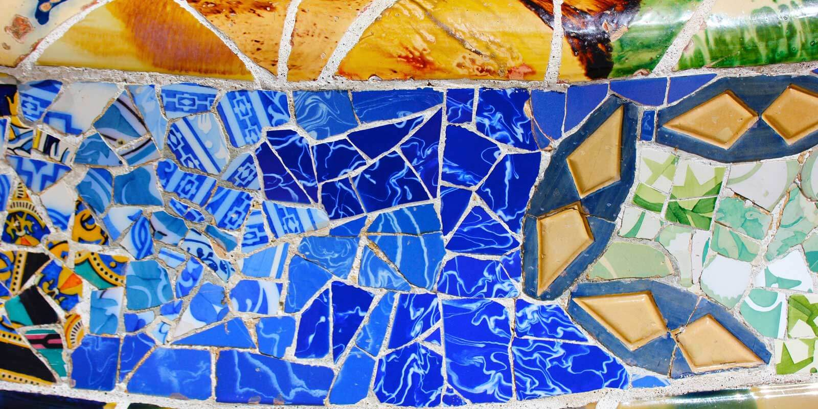 Closeup of crushed Spanish tile mosaic at a park in Spain.