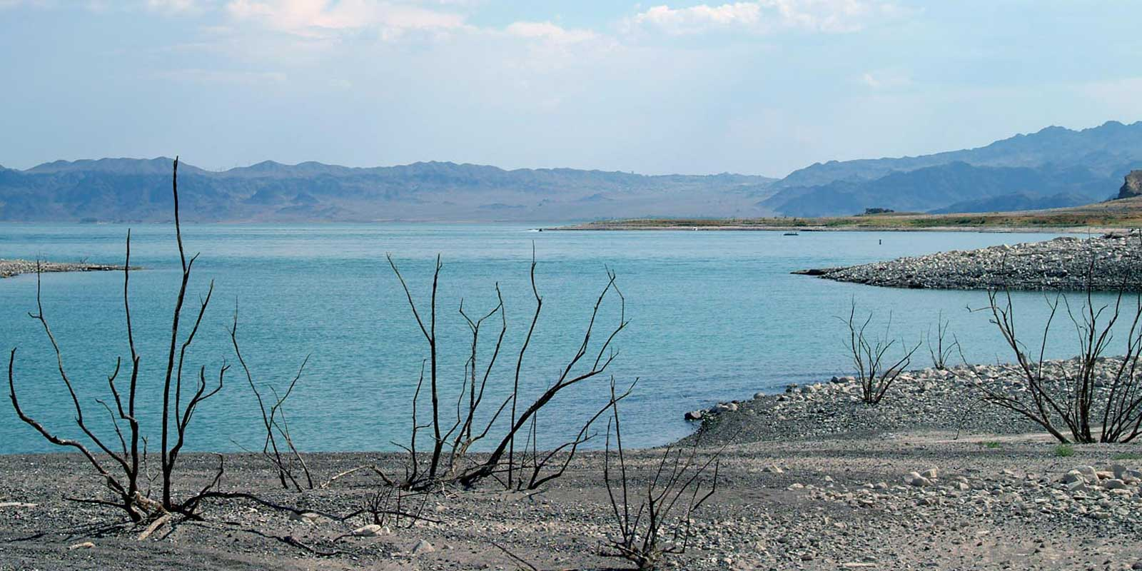 Landscape photo of the barren shoreline at Lake Mead during a drought.
