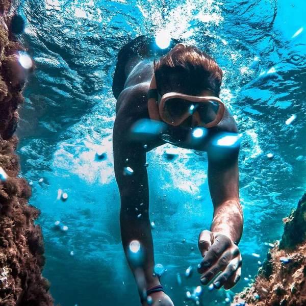 Woman snorkeling amongst coral reef