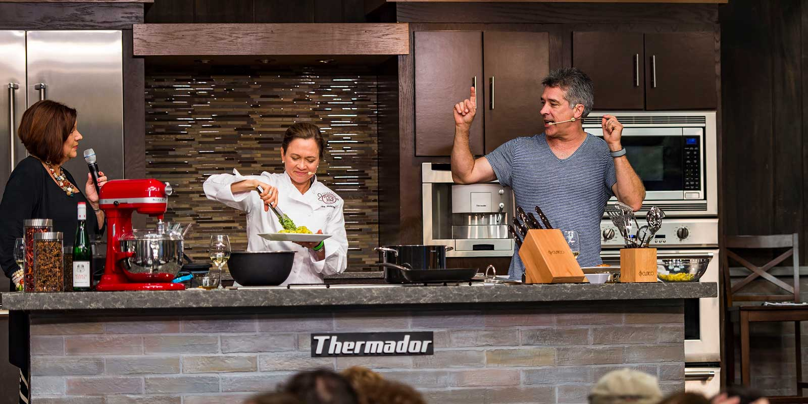 Photo of a cooking demonstration at the Epcot Festival Center during the Epcot International Food and Wine Festival.