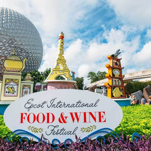 Landscape photo of the official Epcot International Food & Wine Festival at the Epcot park entrance, with the iconic Epcot globe in the bakcground.
