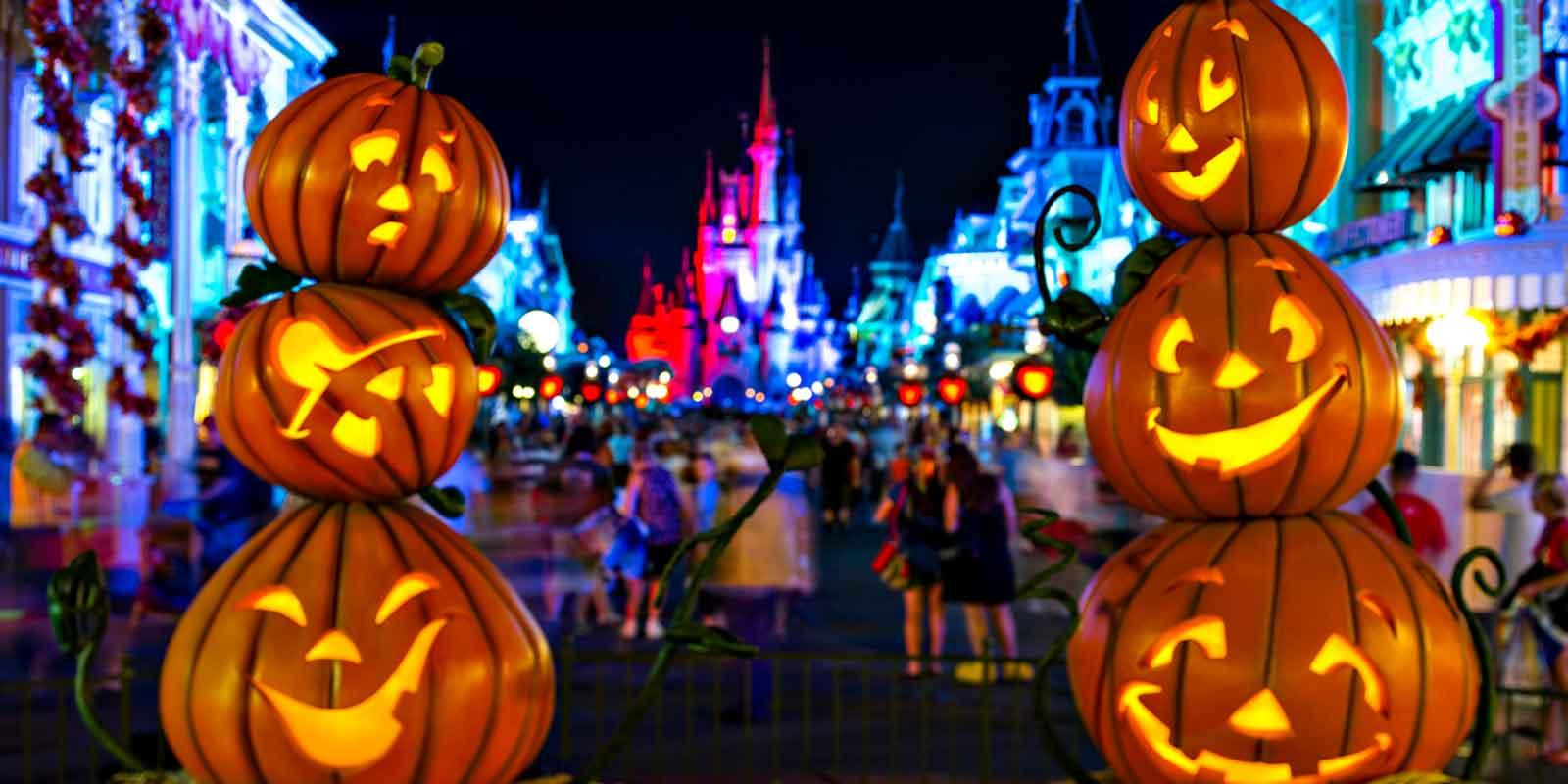 Closeup of 2 vertical stacks of pumpkins framing Cinderella's castle at Magic Kingdom.