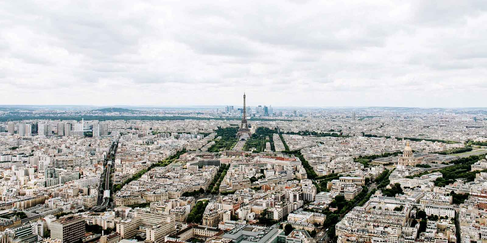 Landscape view of the city of Paris, with the Eiffel Tower in the background.