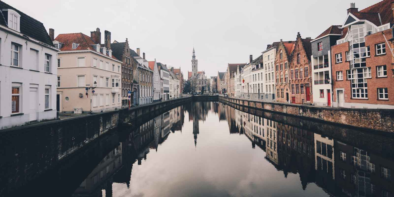 Landscape view of Bruges from the middle of a canal.