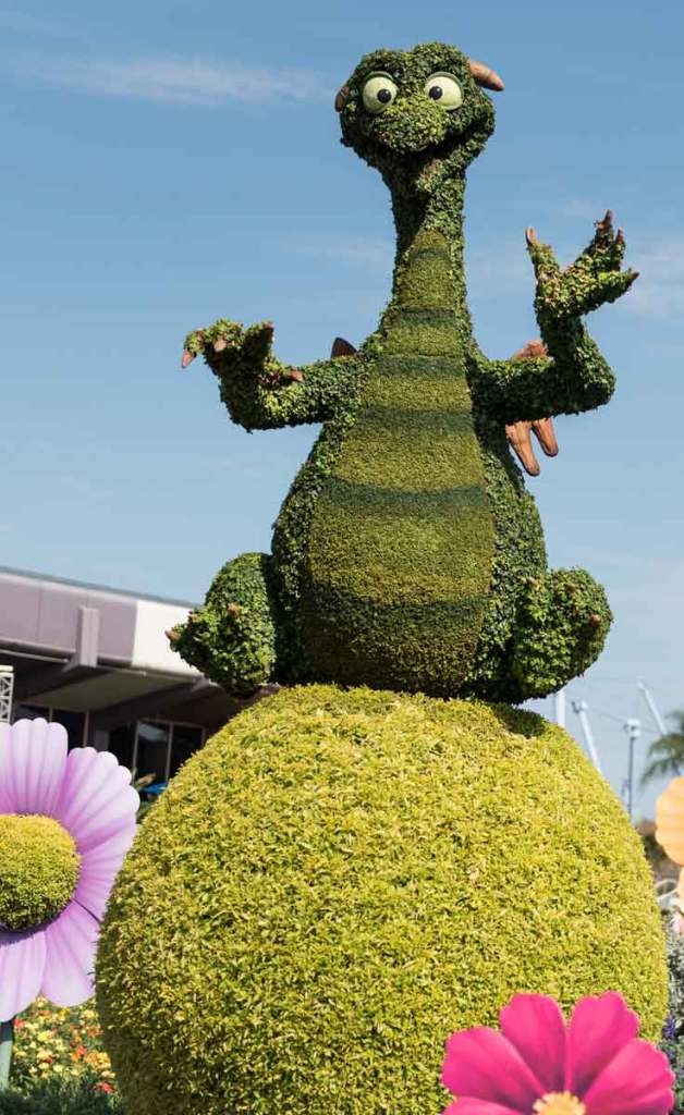 Photograph of a topiary shaped like Figment the dragon at Epcot.