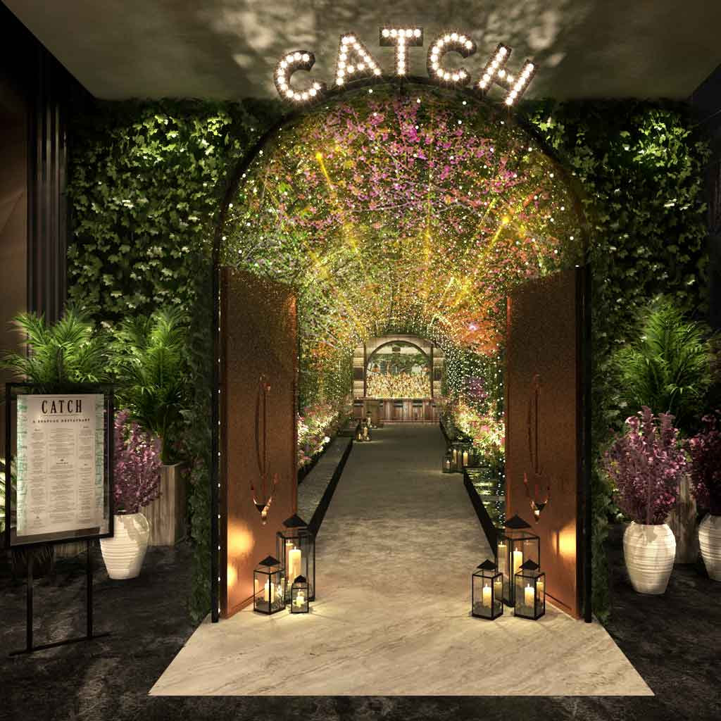 Photograph of the entrance to Catch Las Vegas, complete with twinkling lights, towering plants, and purple flowers.