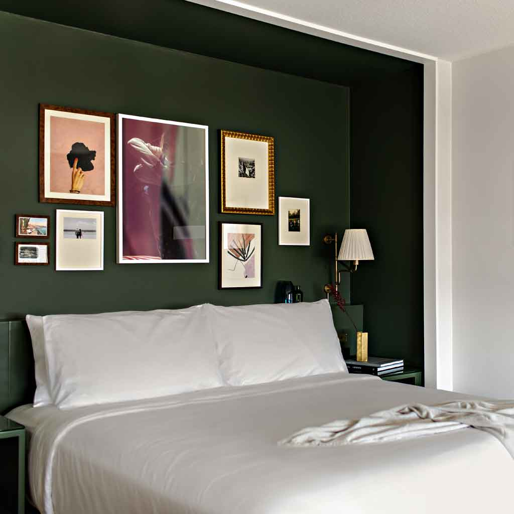 Photograph of the bed and decor of a Park MGM Stay Well room.
