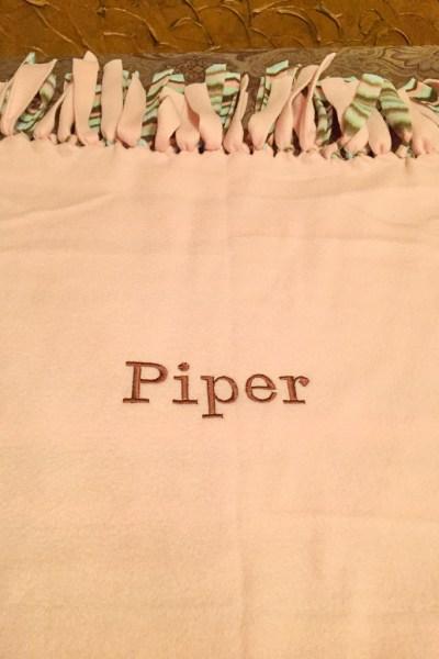 Tied embroidered fleece blanket