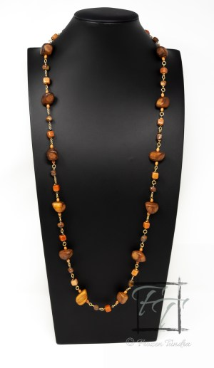 An earthy red and orange rope necklace featuring wood nuggets, red aventurine, chrysanthemum stone, and bone