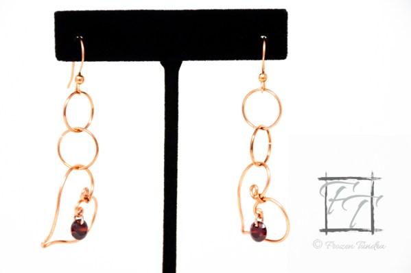 Copper wire heart earrings with garnet red cubic zirconia drops