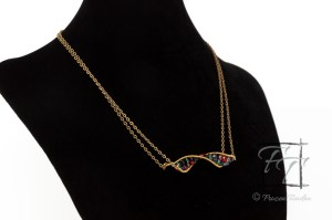 antiqued brass and gold plate DNA double helix design necklace with fire-polished Czech glass beads representing the 4 nucleotides.
