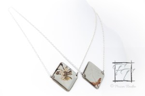 Darwin's Moth pendant in silver plate: images of darwin's orchid and its pollinating moth on opposing sides set in high quality resin on sheet metal.