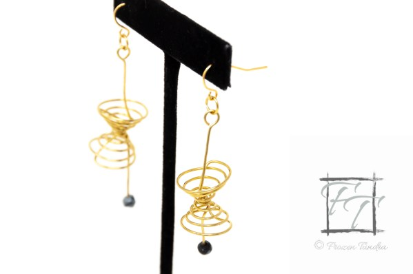 gold and brass lightcone and worldline earrings with snowflake obsidian