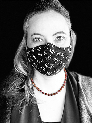 Rachel Brown, black and white profile pic with color necklace, taken at a market during the pandemic