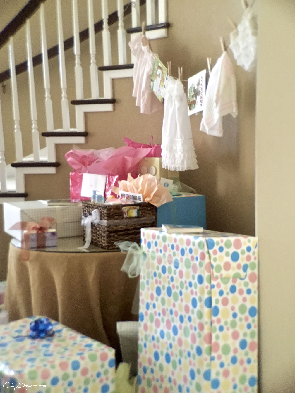 Easy Banner With A Very Personal Touch Hangs Above The Baby Shower Gifts  Table. Using Clothespins To Hang Very Special Baby Clothes U0026 A Couple Story  Books.