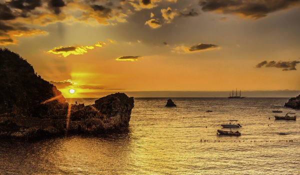 Picture of sailing vessel at sunrise