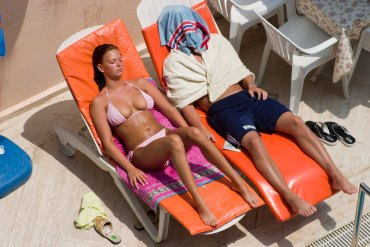 sunbathing couple