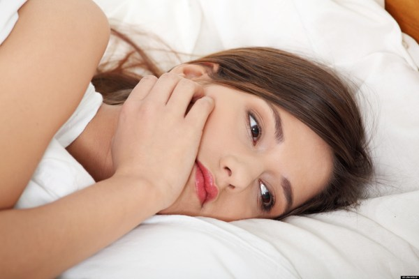 Concerned woman in bed