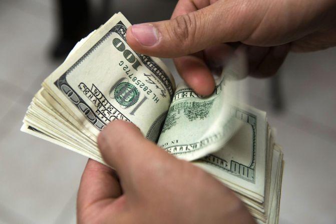 man holding had of money