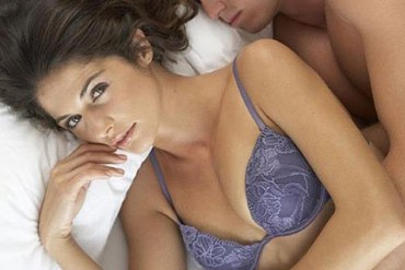 picture of woman in bed with a man