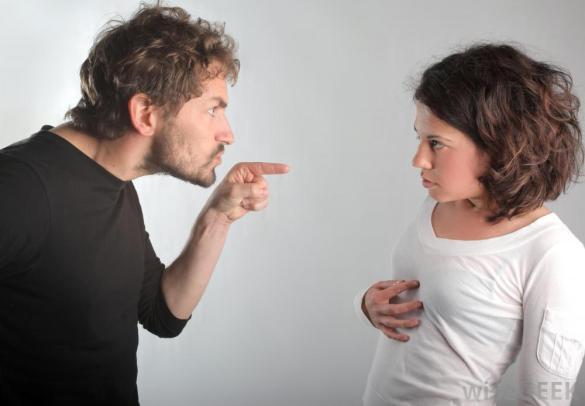 Man pointing at woman