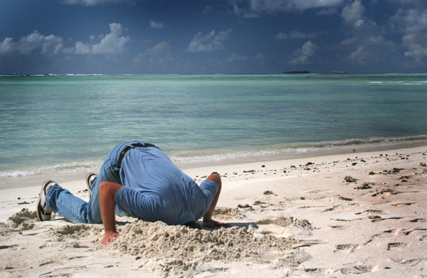 man with his head in the sand