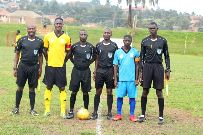Match officials with the two captains of both teams before kickoff