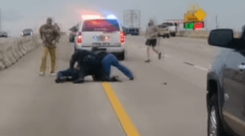 Civilians Aid Police Officer Fighting