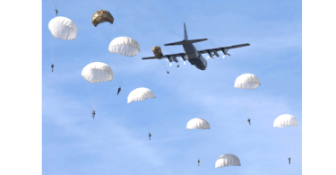 Plane dropping paratroopers