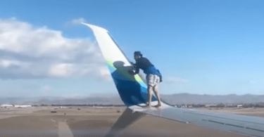 Man climbed onto the wing of a 737