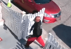 Suspect with gun in right hand caught on camera