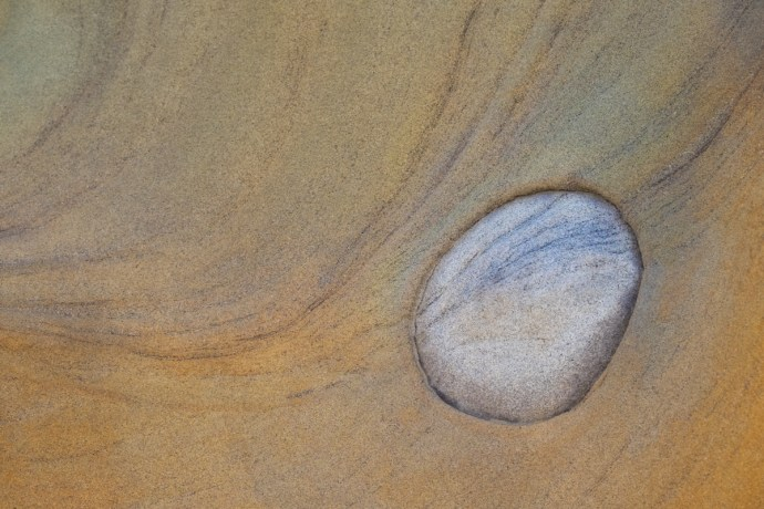 Abstract of a concretion embedded within sand stone found along the Oregon Coastline.