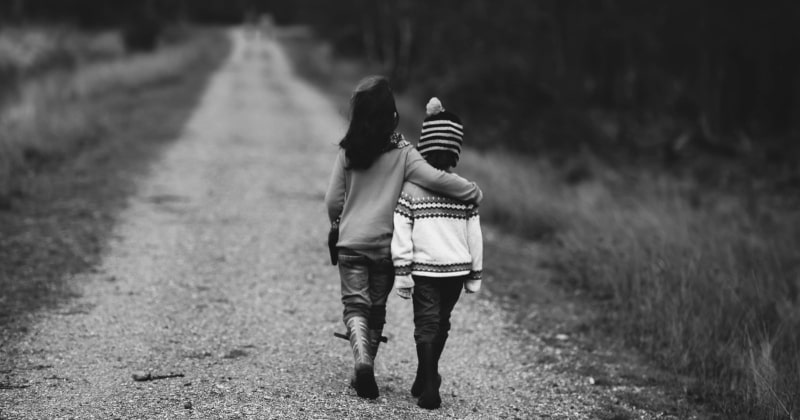 Emotional intelligence during parenthood with two kids walking together