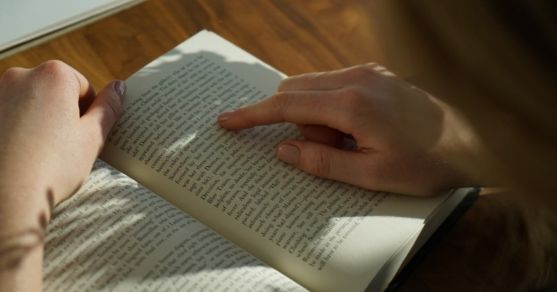 Woman's hand on a book