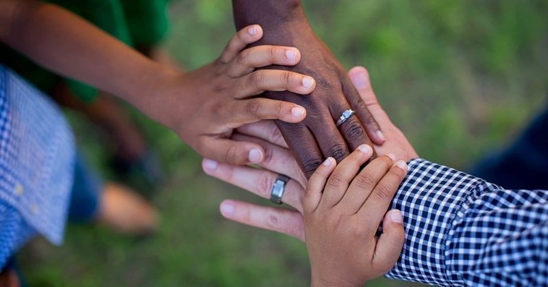 Radiant relationships during parenthood with adult and children hands together
