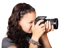 Girl using dslr camera