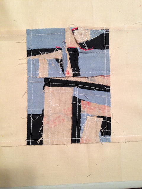 The back of Mary Ann's tiny quilt square. A neat back, is the sign of a professional.