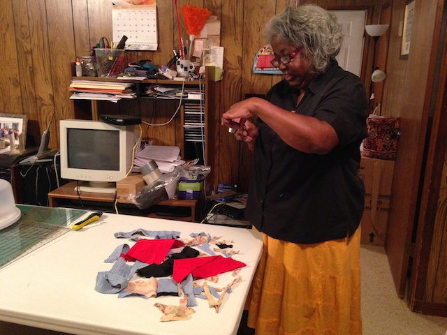 Mary Ann taking a photo of the quilt scraps
