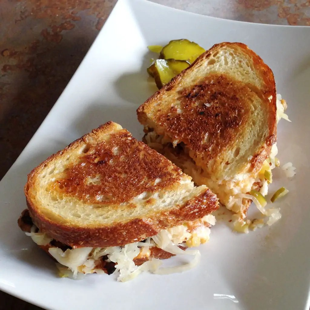 Yummy Vegan Reuben On A Plate With Pickles