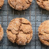 close view of molasses cookies on a cooling rack