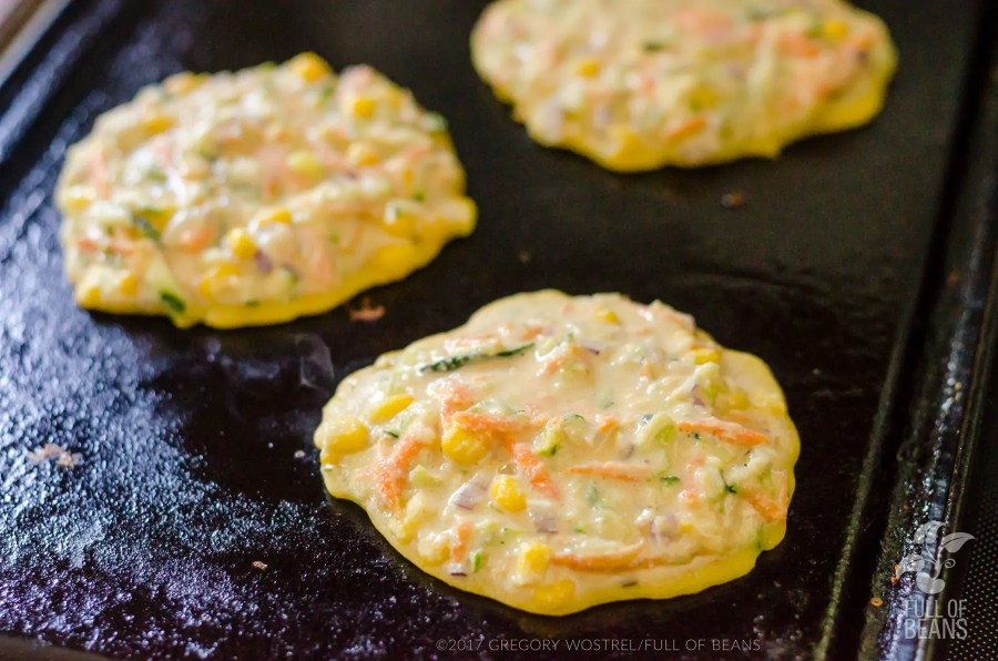fritters cooking on griddle