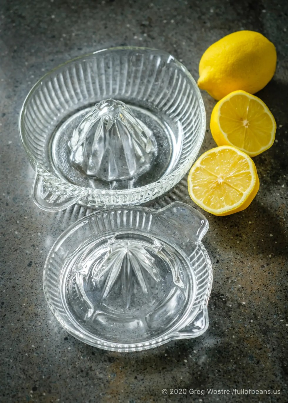 glass citrus juicers with lemons