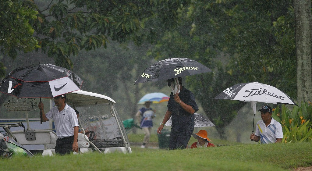 Players head back to the clubhouse after the organizing Pilipinas Golf Tournaments, Inc. called off the third round of the P1.5 million-ICTSI Royal Northwoods Championship due to unplayable conditions.