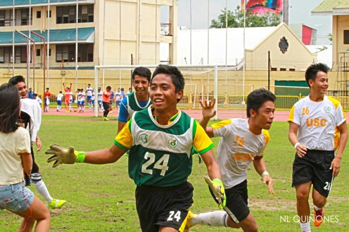 USC players celebrate after winning the tertiary crown via a penalty shootout.