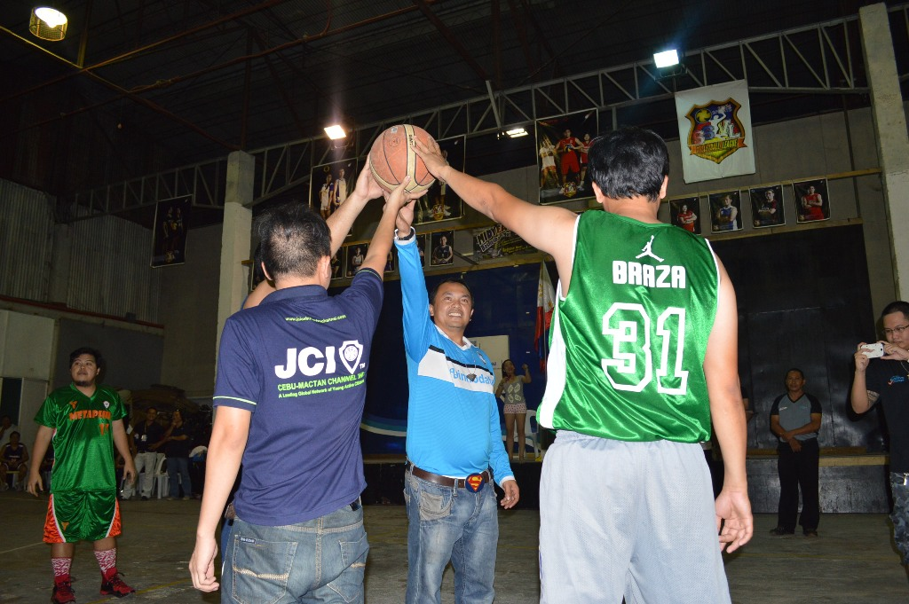 Vincent Joel Gagno and Mcney Bequilla (back to camera) during the ceremonial jump ball.